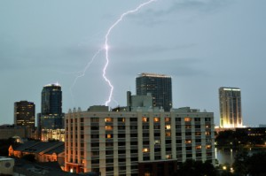 Lightning striking behind some of the buildings in Downtown Orlano, Florida